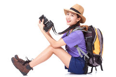 Woman traveler with a camera. On white background Royalty Free Stock Photo