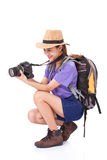 Woman traveler with a camera. On white background Stock Image