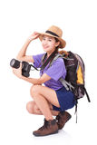 Woman traveler with a camera. On white background Royalty Free Stock Photography