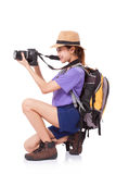 Woman traveler with a camera Stock Images