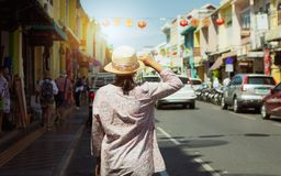Woman traveler in casual dress walking in thalang road with chino portuguese style building stock images