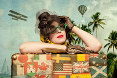 Woman Traveler Embraces A Vintage Suitcase. Photo In Old Image S Royalty Free Stock Photos