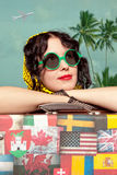 Woman traveler embraces a vintage suitcase. Photo in old image s Stock Photography