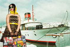 Woman traveler embraces a vintage suitcase Royalty Free Stock Photos