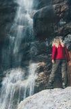 Woman Traveler enjoying waterfall Royalty Free Stock Photo
