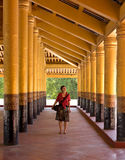 Woman traveler between gold columns of Royal Palace in Mandalay Stock Images