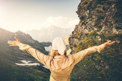 Woman Traveler hands raised hiking Travel Lifestyle concept Summer adventure Stock Photography