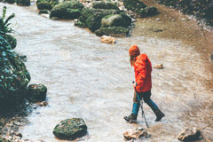 Free Woman Traveler Hiking Crossing Stream Royalty Free Stock Images - 82913379