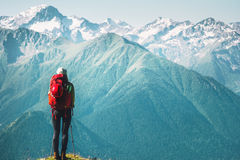 Woman Traveler hiking enjoying mountains landscape. Travel Lifestyle concept adventure summer vacations outdoor with backpack Royalty Free Stock Images
