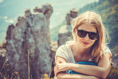 Woman Traveler hiking in Mountains Stock Photos