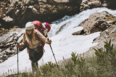 Woman traveler hiking at mountains. Travel Lifestyle wanderlust adventure concept summer vacations outdoor wild nature Royalty Free Stock Photography