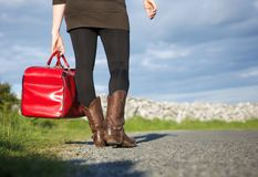 Woman traveler holding red bag Stock Image