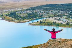 Woman Traveler at Lake Tekapo, New Zealand. Woman traveller enjoys scenic view of lake Tekapo landscape in New Zealand Stock Image