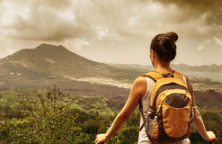 Woman traveler looking at Batur volcano. Indonesia Stock Photos