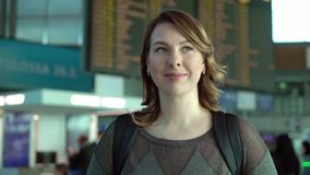 Woman looking at information board in airport. Woman traveler looking at information board in airport stock video footage