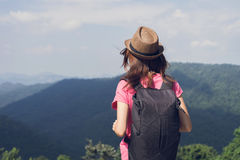 Woman traveler looking at the mountain Stock Image