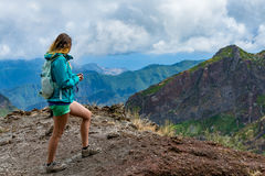 Woman traveler at Madeira mountain hiking path. Stock Image