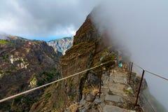 Woman traveler at Madeira mountain hiking path. stock photography