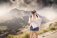 Woman traveler with map on high mountains Stock Photo