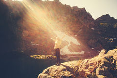 Woman Traveler meditating yoga relaxing alone standing on cliff Royalty Free Stock Images