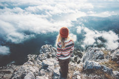 Woman traveler on mountain summit over clouds. Enjoying aerial view Travel Lifestyle success concept adventure active vacations outdoor harmony with nature Royalty Free Stock Photos
