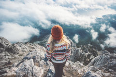Woman traveler on mountain summit over clouds. Travel Lifestyle success concept adventure active vacations outdoor harmony with nature Stock Photography