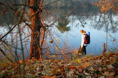 Woman traveler near forest river in autumn Royalty Free Stock Images