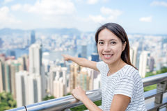 Woman traveler pointing to city of Hong Kong Stock Images