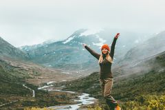 Woman traveler raised hands outdoor happy emotions Royalty Free Stock Image