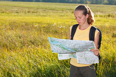 Woman traveler read the map Royalty Free Stock Images