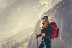 Woman Traveler with red backpack hiking Royalty Free Stock Images