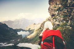 Woman Traveler with red backpack mountaineering Royalty Free Stock Photography