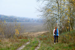 Woman traveler relax on the autumn nature Stock Images