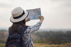 Woman searching direction on location map while traveling stock image