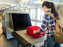 Machine detection metal to prevention terrorist. Woman traveler selective focus Baggage X-ray machine try to detection metal prevention bad terrorist to attack stock photography