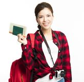 Woman traveler showing passport and ticket. Young Woman traveler showing passport and ticket Royalty Free Stock Photo