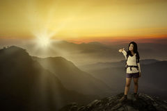 Woman traveler showing thumb in the sunset Royalty Free Stock Photography