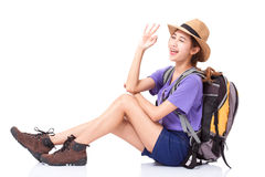 Woman traveler sitting on the floor and showing ok sign stock images