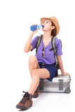 Woman traveler sitting on suitcase with backpack royalty free stock photography