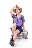 Woman traveler sitting on suitcase Stock Photography