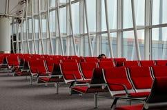 Woman traveler sleeps at Hong Kong Airport Stock Photo
