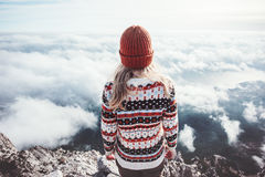 Woman traveler standing on mountain summit over clouds Royalty Free Stock Photography