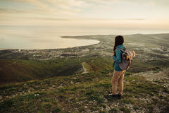 Woman traveler standing on peak of mountain Stock Photography