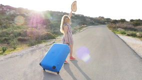 Woman traveler with suitcase running. Travel concept stock video