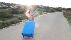 Woman traveler with suitcase running. Travel concept stock footage