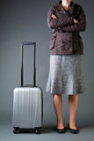 Woman Traveler with Suitcase Waiting Royalty Free Stock Photography