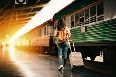 Woman traveler tourist walking with luggage at train station. Active and travel lifestyle concept royalty free stock images