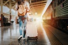 Woman traveler tourist walking with luggage royalty free stock photos