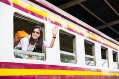 Woman traveler on train stock image