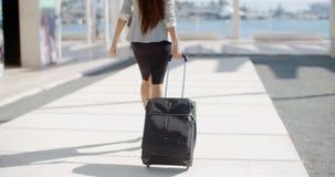 Woman traveler in an urban street stock video